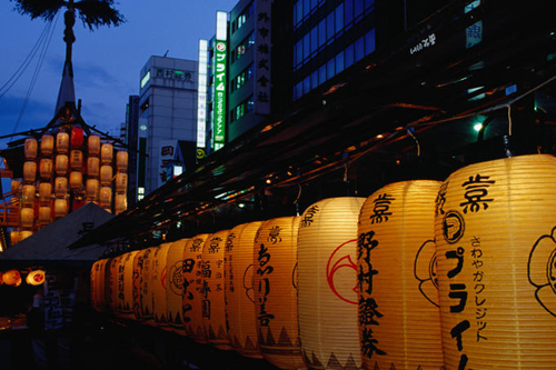 Paper lanterns light a wagon on the night before Gion Matsuri in Kyoto.