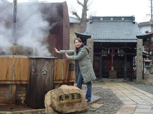a beautiful Japanese girl is smiling sweetly before enjoying the hot spring at Arima Onsen