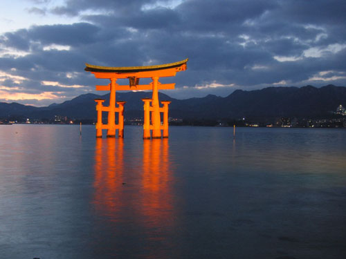 Illuminated floating torii gate of Itsukushima Shrine, Miyajima, Japan