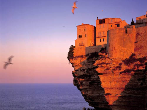 Precariously hanging houses at Corsica Island. Explore this exotic destination in the Mediterranean that few know!