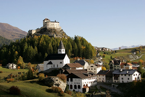 schloss tarasp looms over a steeply inclined rock situated over the valley of engadin Travel To Switzerland   Top 10 Best Places