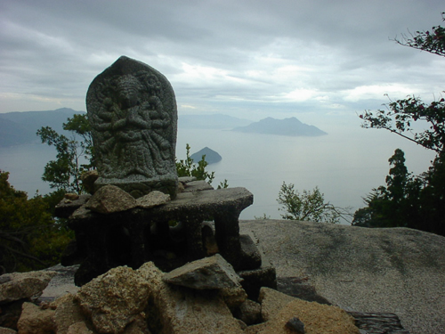Shrine on the pinnacle of Mt. Misen blends in with its panoramic background to show the spiritual side, as well as the natural beauty of the holy place.