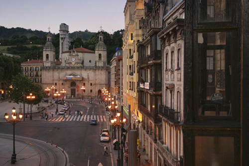 streetlights church and streetscape at sunset near plaza santiago Travel To Spain   Top 10 Best Places