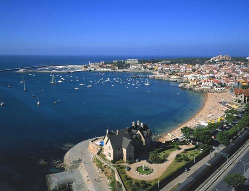 the beautiful cascais sea front spotted with summer crowds at praia da rainha the queens beach Travel To Portugal   Top 10 Best Places