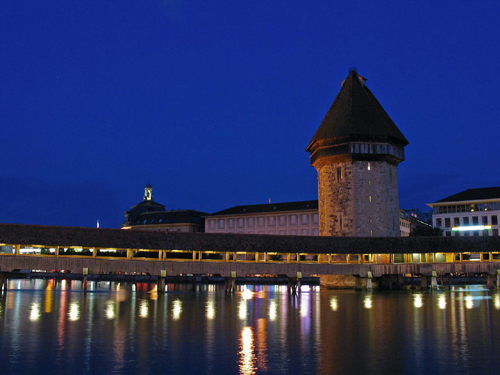 The Kapellbrucke a.k.a Chapel Bridge in Lucerne at late dusk. It is one of the most photographed spot in Switzerland.