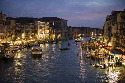 Venice's Grand Canal at dusk, seen from Rialto Bridge.