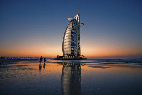 Burj Al Arab Hotel reflected on beach at sunset, Dubai, United Arab Emirates (UAE)