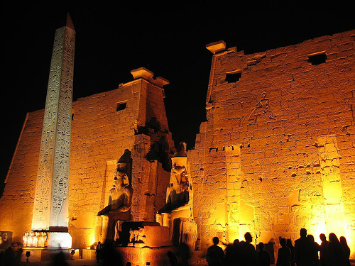 Luxor Temple at night. The light show creates an eerie spectacle as the temple is lit up and the statues and Obelisk are featured