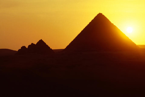 Sunset over ancient egypt pyramids.