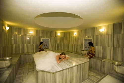 woman smiling to the camera on the marble at a hamam turkish bath Travel To Turkey   Top 10 Best Places