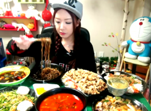 This South Korean Girl is Making Over $100,000 A Year Eating With Her Camera